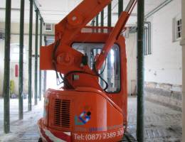 Mini crane in a confined indoor space