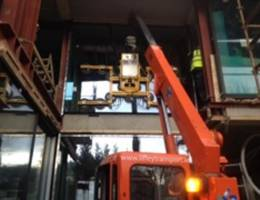 Mini Crane Hire for use in glass lifting