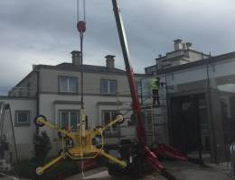 Spider Crane Hire - UNIC URW-376 with the MRTA8 Quadra-Tilt Vacuum Lifter